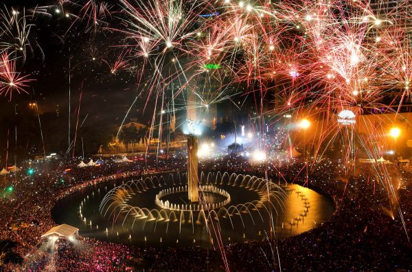 Fireworks light up the sky as thousands of people gather to watch, in the main business district on New Year's Eve in Jakarta, Indonesia. (Tatan Syuflana/Associated Press)